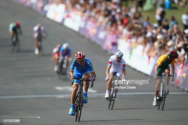 Yegor Dementyev of Ukraine leads into the last lap on his way to winning gold in the Men's Individual C4-5 road race on day 8 of the London 2012...