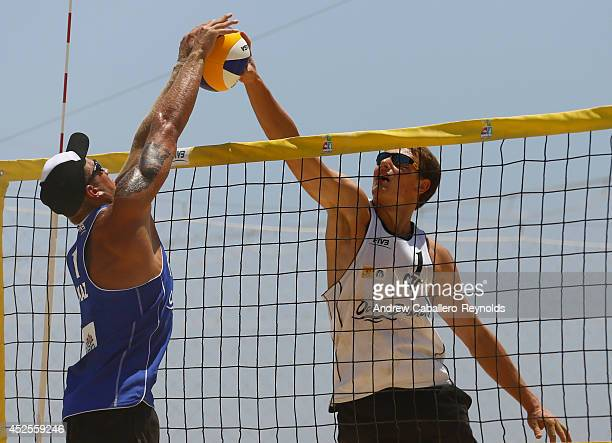 Yegor Dmitriyev from Kazakhstan and Ondrej Perusic from the Czech Republic fight for the ball at the FIVB Under 21 Beach Vollyball World...