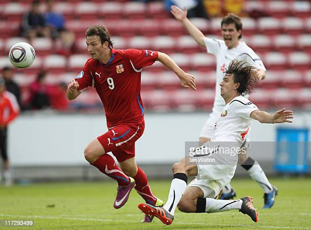Yegor Filipenko of Belarus attempts a tackle on Libor Kozak of Czech Republic during the UEFA European U21 Championship third place playoff match...