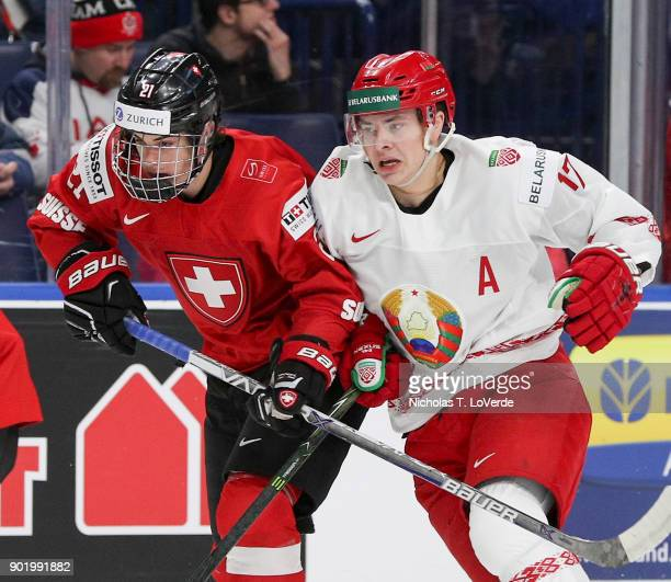 Yegor Sharangovich of Belarus battles with Tim Berni of Switzerland during the first period of play in the IIHF World Junior Championships at the...