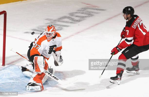 Yegor Sharangovich of the New Jersey Devils sends a shot off the crossbar during a shorthanded breakaway during the first period against Brian...