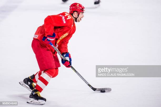 Yegor Yakovlev of Russia controls the puck during the group A match Russia v Sweden of the 2018 IIHF Ice Hockey World Championship at the Royal Arena...