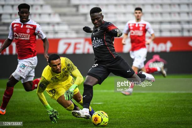 Yehvann DIOUF of Reims and Moussa KONE of Nimes during the Ligue 1 Uber Eats match between Stade de Reims and Nimes Olympique at Stade Auguste...