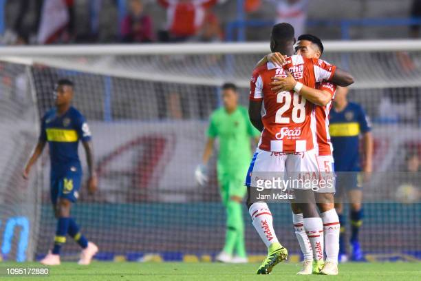 Yeimar Gómez Andrade and Nelson Acevedo of Union celebrate the opening goal scored by Augusto Lotti during a friendly match between Boca Juniors and...