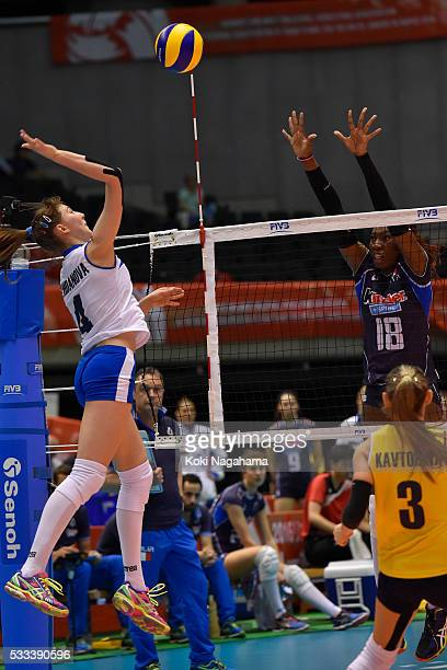 Yekaterina Zhdanova of Kazakhstan spikes the ball during the Women's World Olympic Qualification game between Italy and Kazakhstan at Tokyo...