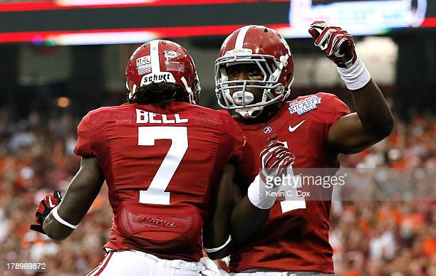 Yeldon of the Alabama Crimson Tide celebrates scoring a touchdown against the Virginia Tech Hokies with Kenny Bell at Georgia Dome on August 31, 2013...
