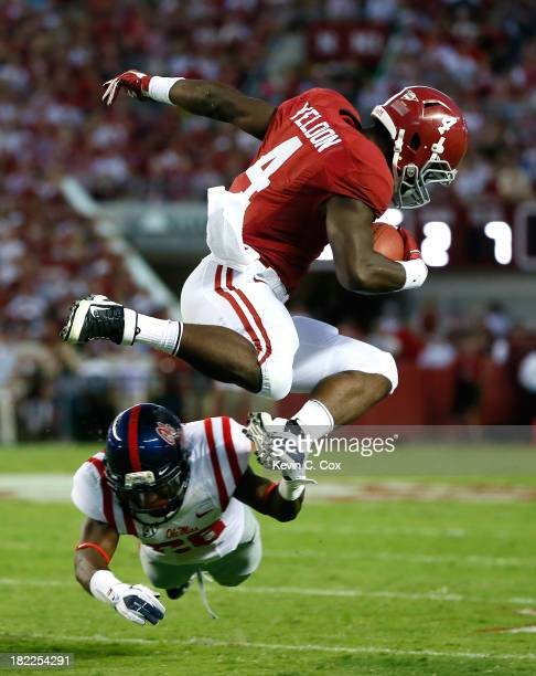 Yeldon of the Alabama Crimson Tide leaps over Mike Hilton of the Mississippi Rebels at Bryant-Denny Stadium on September 28, 2013 in Tuscaloosa,...