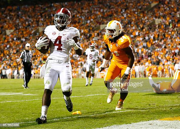 Yeldon of the Alabama Crimson Tide rushes in for a touchdown against Jalen Reeves-Maybin of the Tennessee Volunteers at Neyland Stadium on October...