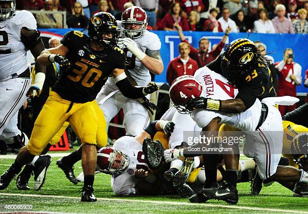 J Yeldon of the Alabama Crimson Tide scores a touchdown against the defense of Markus Golden of the Missouri Tigers in the second quarter of the SEC...