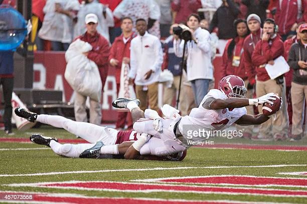 J Yeldon of the Alabama Crimson Tide stretches for a touchdown against the Arkansas Razorbacks at Razorback Stadium on October 11 2014 in...