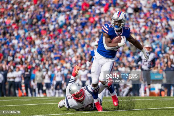 J Yeldon of the Buffalo Bills attempts to evade a tackle by Kyle Van Noy of the New England Patriots during the third quarter at New Era Field on...