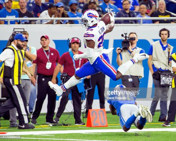 Yeldon of the Buffalo Bills leaps over a tackle attempt from Johnathan Alston of the Detroit Lions during the 2nd half of an NFL Pre-season game at...