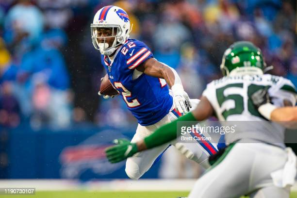 Yeldon of the Buffalo Bills leaps through the air while carrying the ball during the third quarter against the New York Jets at New Era Field on...