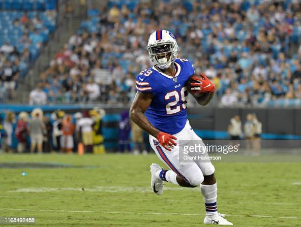Yeldon of the Buffalo Bills runs against the Carolina Panthers during the second quarter of their preseason game at Bank of America Stadium on August...
