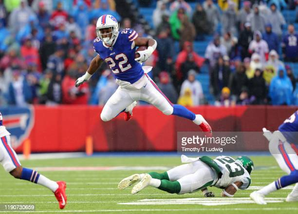 Yeldon of the Buffalo Bills runs the ball and jumps to avoid a tackle by Arthur Maulet of the New York Jets at New Era Field on December 29, 2019 in...