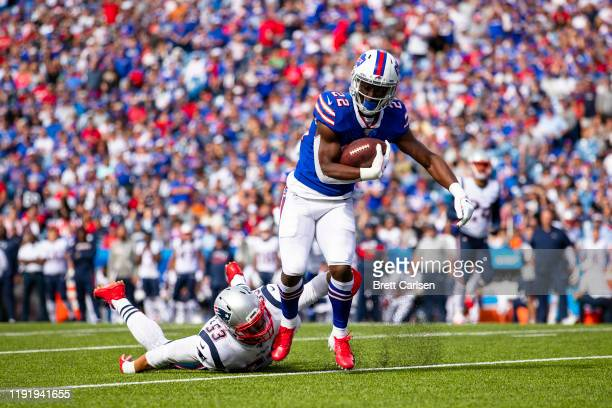 Yeldon of the Buffalo Bills runs with the ball as he evades Kyle Van Noy of the New England Patriots during the third quarter at New Era Field on...