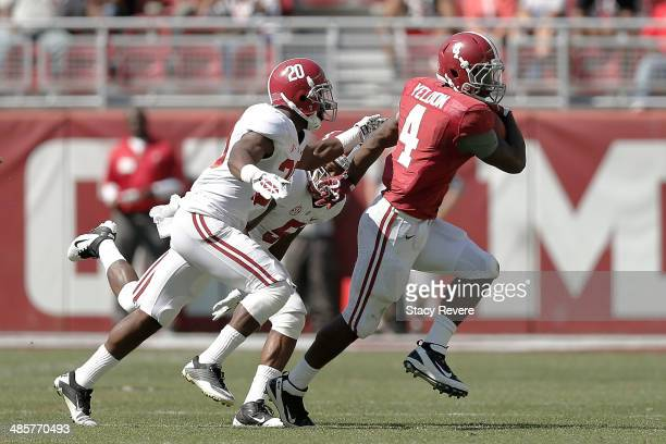 Yeldon of the Crimson team is brought down by Cyrus Jones and Jarrick Williams of the White team during the University of Alabama A-Day spring game...