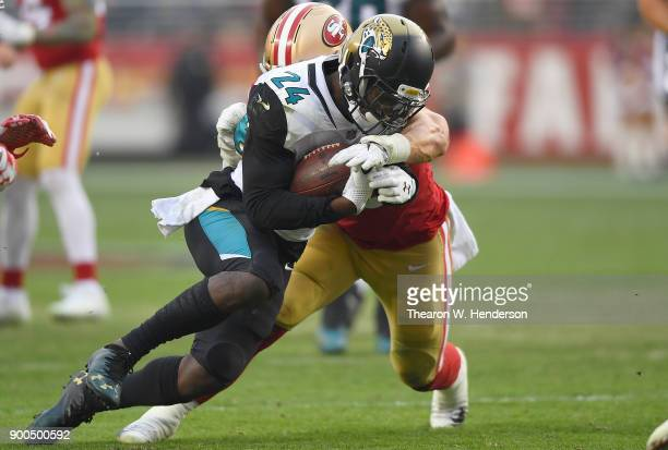 Yeldon of the Jacksonville Jaguars carries the ball while pursued by Brock Coyle of the San Francisco 49ers during their NFL football game at Levi's...
