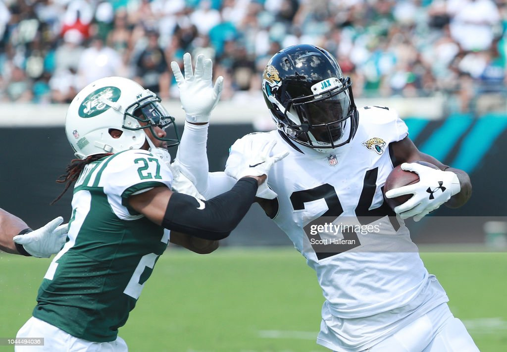 t.j. yeldon of the jacksonville jaguars fights off the tackle of