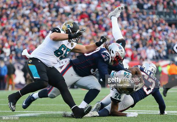 Yeldon of the Jacksonville Jaguars is tackled after a catch in the first half during the AFC Championship Game against the Jacksonville Jaguars at...