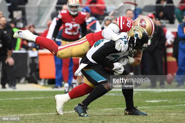 Yeldon of the Jacksonville Jaguars is tackled by Brock Coyle of the San Francisco 49ers during their NFL game at Levi's Stadium on December 24, 2017...
