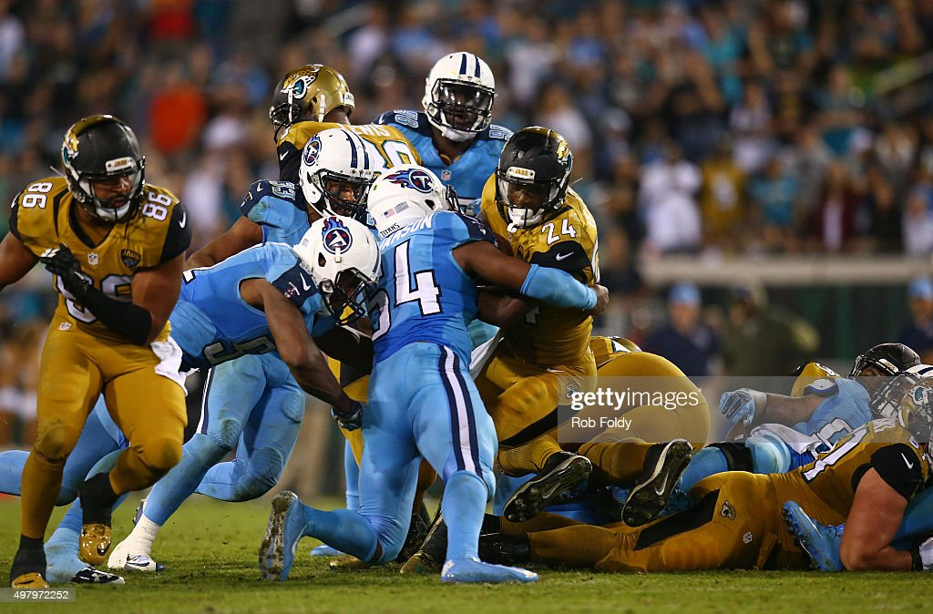 T.J. Yeldon #24 of the Jacksonville Jaguars pushes for a first down during the second half of the game against the Tennessee Titans at EverBank Field on November 19, 2015 in Jacksonville, Florida.