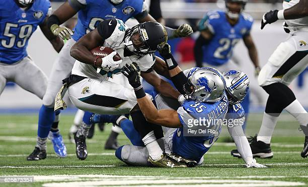 Yeldon of the Jacksonville Jaguars runs the ball and tackled by Miles Killebrew of the Detroit Lions at Ford Field on November 20, 2016 in Detroit,...