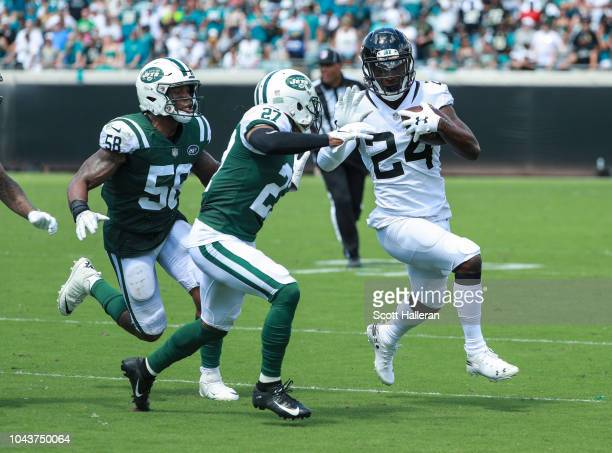 Yeldon of the Jacksonville Jaguars runs with the ball against the New York Jets at TIAA Bank Field on September 30, 2018 in Jacksonville, Florida.