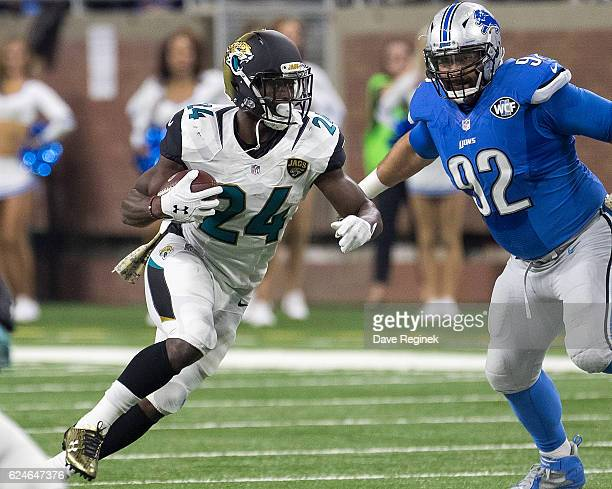 Yeldon of the Jacksonville Jaguars runs with the ball in front of Haloti Ngata of the Detroit Lions during an NFL game at Ford Field on November 20,...