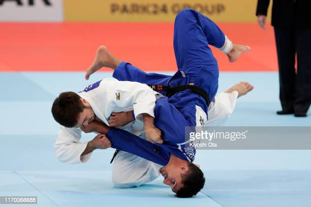 Yeldos Smetov of Kazakhstan and Ali Khousrof of Yemen compete in the Men's 60kg Pool B fourth round on day one of the World Judo Championships at the...