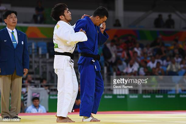 Yeldos Smetov of Kazakhstan consoles Diyorbek Urozboev of Uzbekistan after defeating him in the Men's 60 kg Judo on Day 1 of the Rio 2016 Olympic...