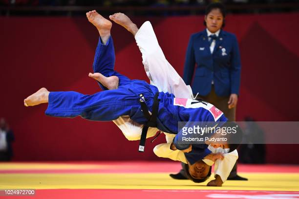 Yeldos Smetov of Kazakhstan fights against Jae Yong An of PRK during Men's Judo -60kg Quarterfinals at JCC Plenary Hall on day eleven of the Asian...
