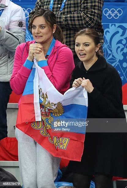 Yelena Isinbayeva and Alina Kabayeva attend the Short Track events on day 3 of the Sochi 2014 Winter Olympics at Iceberg Skating Palace on February...