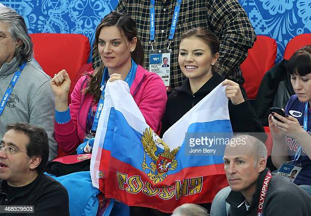 Yelena Isinbayeva and Alina Kabayeva attend the Short Track events on day 3 of the Sochi 2014 Winter Olympics at Iceberg Skating Palace on February...