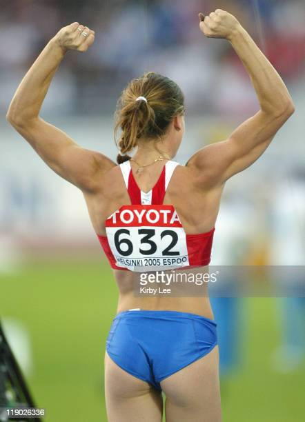 Yelena Isinbayeva of Russia celebrates a worldrecord clearance of 165 1/4 in the women's pole vault in the IAAF World Championships in Athletics at...