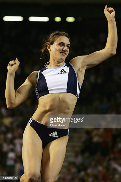 Yelena Isinbayeva of Russia celebrates after setting a new world record in the Women's Pole Vault at the IAAF Golden League Meet in the Roi Baudouin...