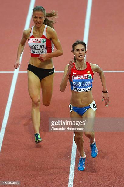 Yelena Korobkina of Russia leads Sviatlana Kudzelich of Belarus to win the Women's 3000 metres Final during day two of the 2015 European Athletics...