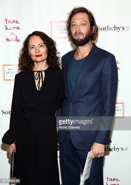 Yelena Yemchuk and Ebon MossBachrach attends Take Home A Nude Benefiting New York Academy Of Art at Sotheby's on October 24 2016 in New York City