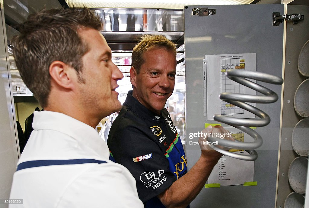 J J Yeley , driver of the DLP HDTV Toyota, shows actor Kiefer