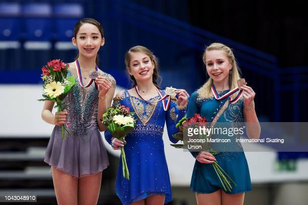 Yelim Kim of Korea Alena Kostornaia of Russia Viktoria Vasilieva of Russia pose in the Junior Ladies medal ceremony during the ISU Junior Grand Prix...