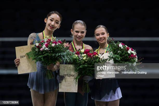 Yelim Kim of Korea Alexandra Trusova and Kseniia Sinitsyna of Russia pose in the Junior Ladies medal ceremony during day two of the ISU Junior Grand...