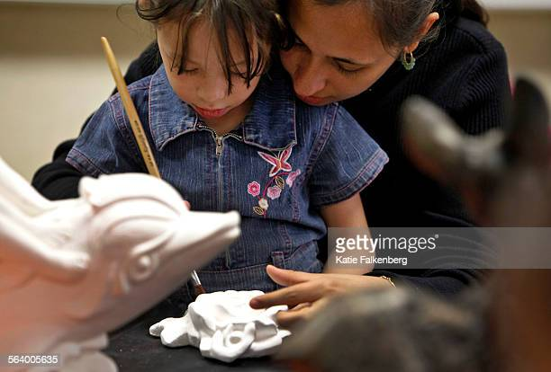 Yelitza Padron helps her daughter Alison Jimenez age 4 work on a craft at the Gault Street Elementary School parent center in Van Nuys LAUSD's parent...