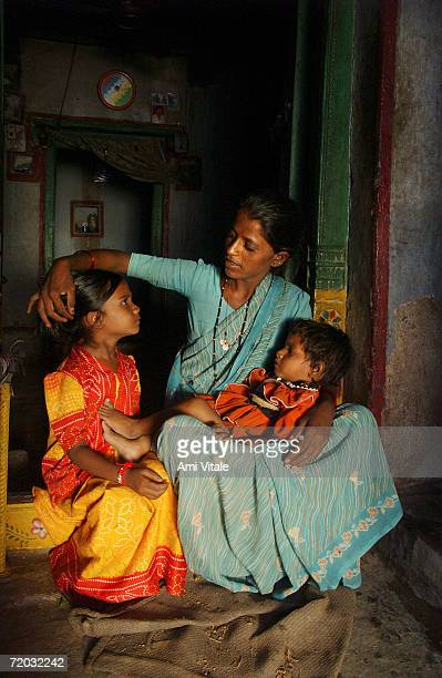 Yellama combs her daughters hair Anitha 5 and Kavitha 4 in her home in this photo taken on August 23 2005 in Mehbubnagar in Andhra Pradesh India She...