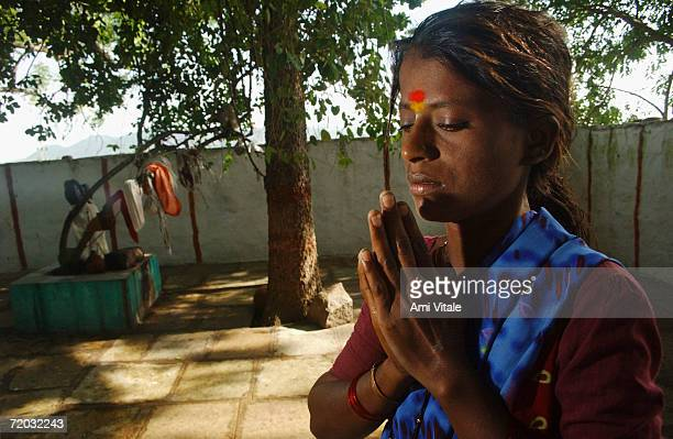 Yellama prepares to worship the goddess she has been named after in this photo taken on August 23 2005 in Mehbubnagar in Andhra Pradesh India She is...
