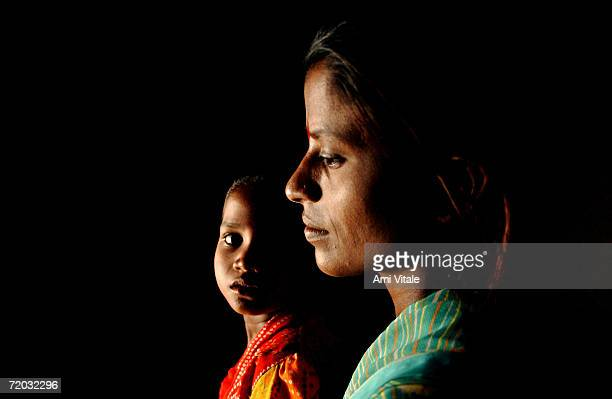 Yellama relaxes in her home with her daughter Anitha in this photo taken on August 23 2005 in Mehbubnagar in Andhra Pradesh India She is a Jogini or...