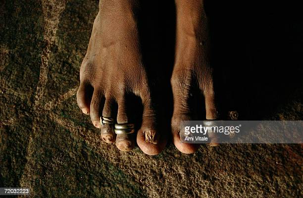 Yellama wears toe rings which signify that she is married to the goddess she has been named after in her home in this photo taken on August 23 2005...