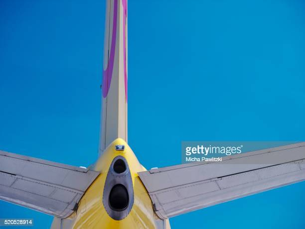 Yellow Aircraft against Blue Sky