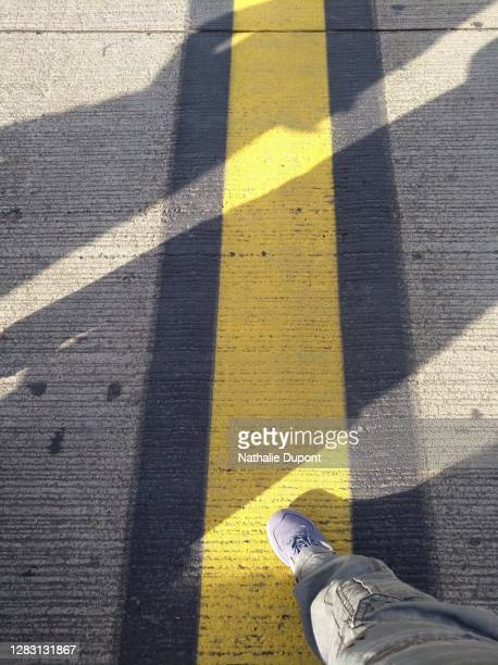yellow and black marking on airport tarmac - charleroi stock pictures, royalty-free photos & images