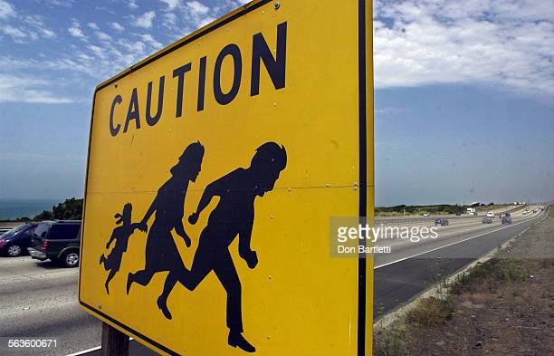 Yellow and black sign warning motorists of pedestrians on I–5 near the Border Patrol checkpoint Camp Pendleton CA For about 10 years the signs...