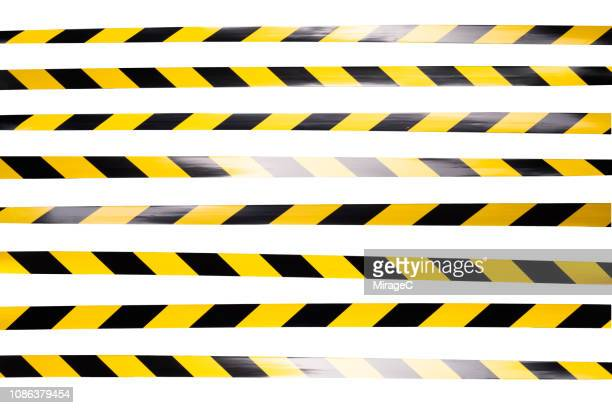 yellow and black striped cordon tape - verboten stock-fotos und bilder